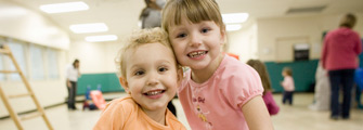 Two pre-school aged girls at community centre